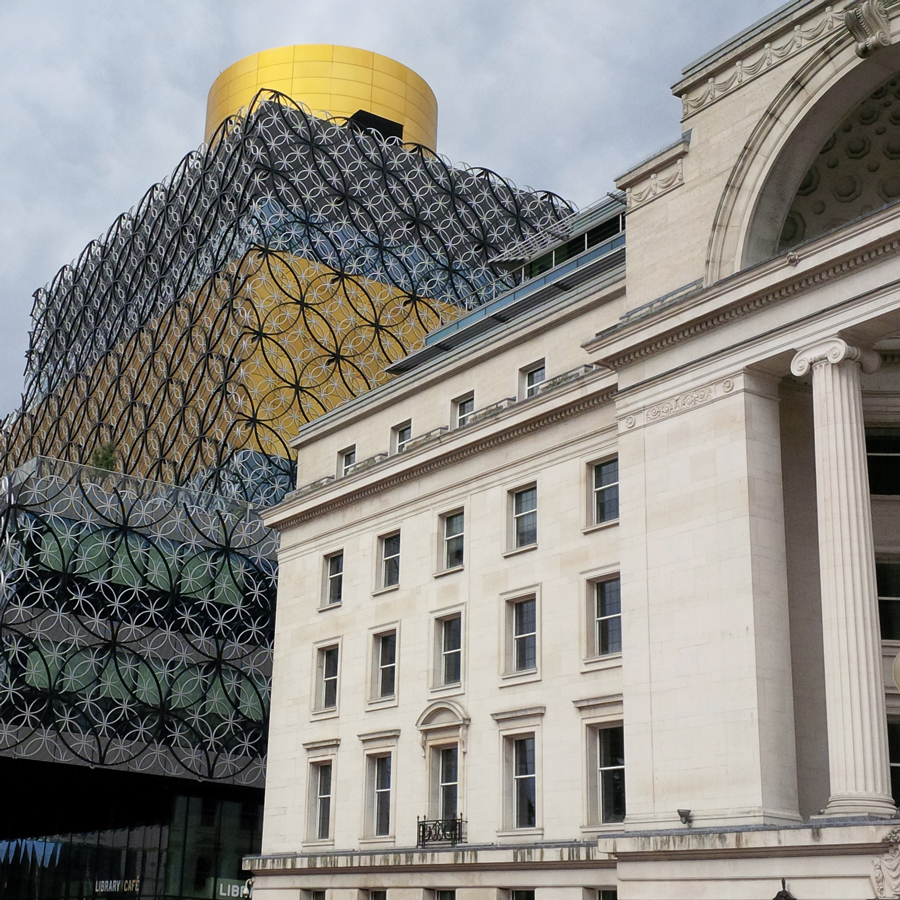 The Baskerville House (right) and the Birmingham Library (left)