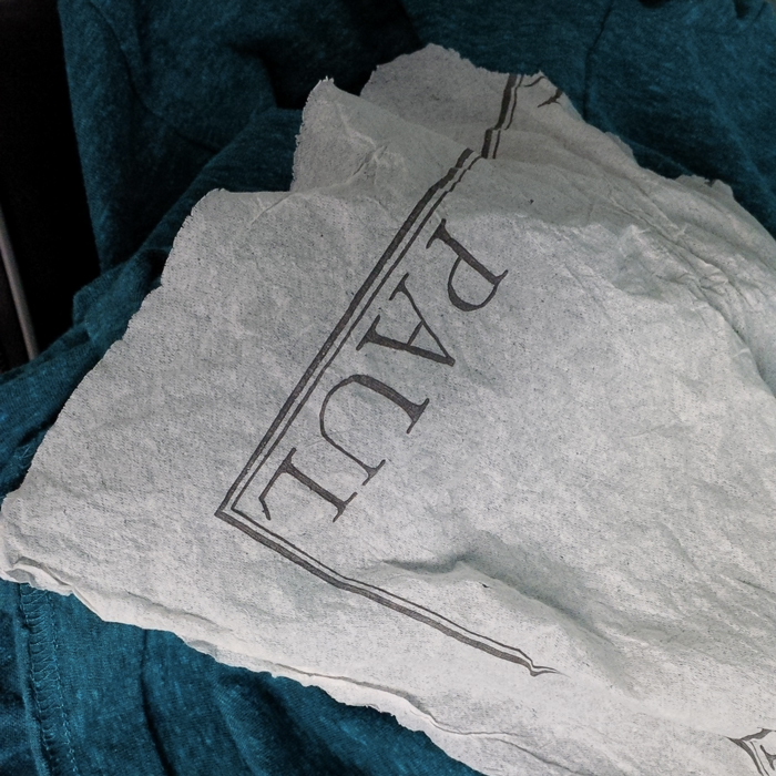 This paper napkin survived the washing machine and the dryer
