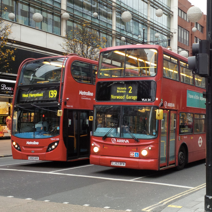 Two archetypal London buses in Oxford St.